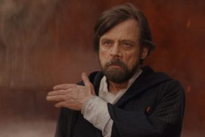 Luke Skywalker casually brushes imaginary dust from his shoulder.